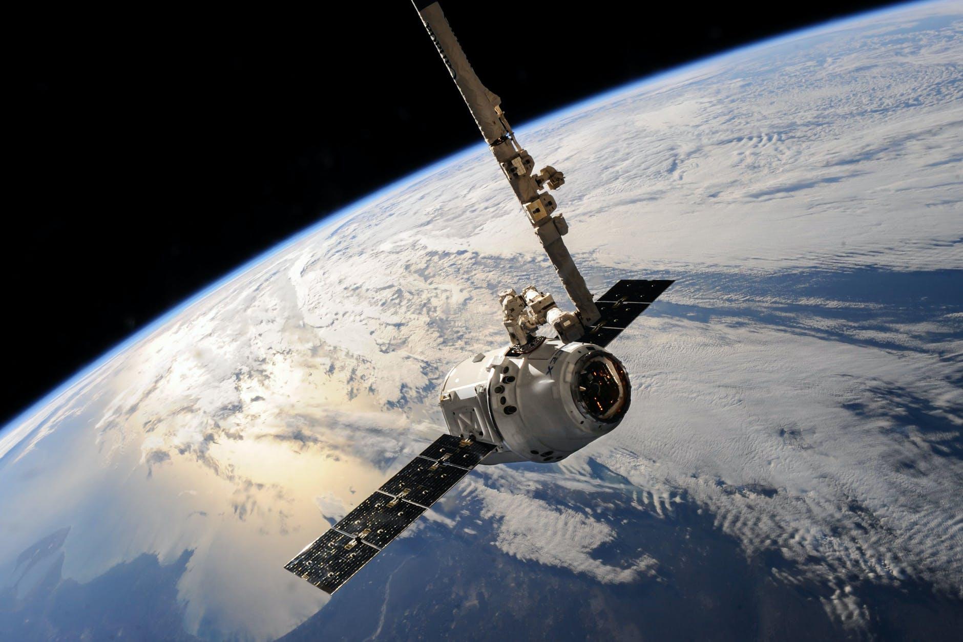 white outer space satellite